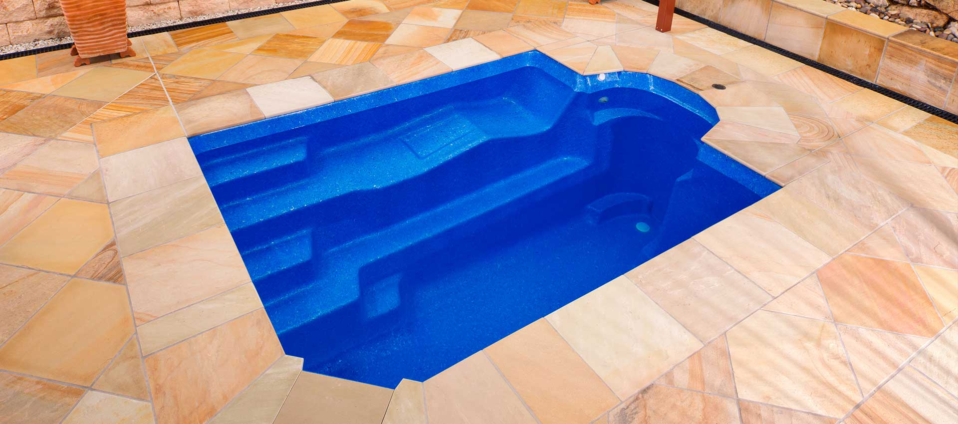 Kimberley Plunge pool with travertine paving